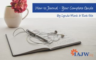 How to Journal Header Image of journal with pen