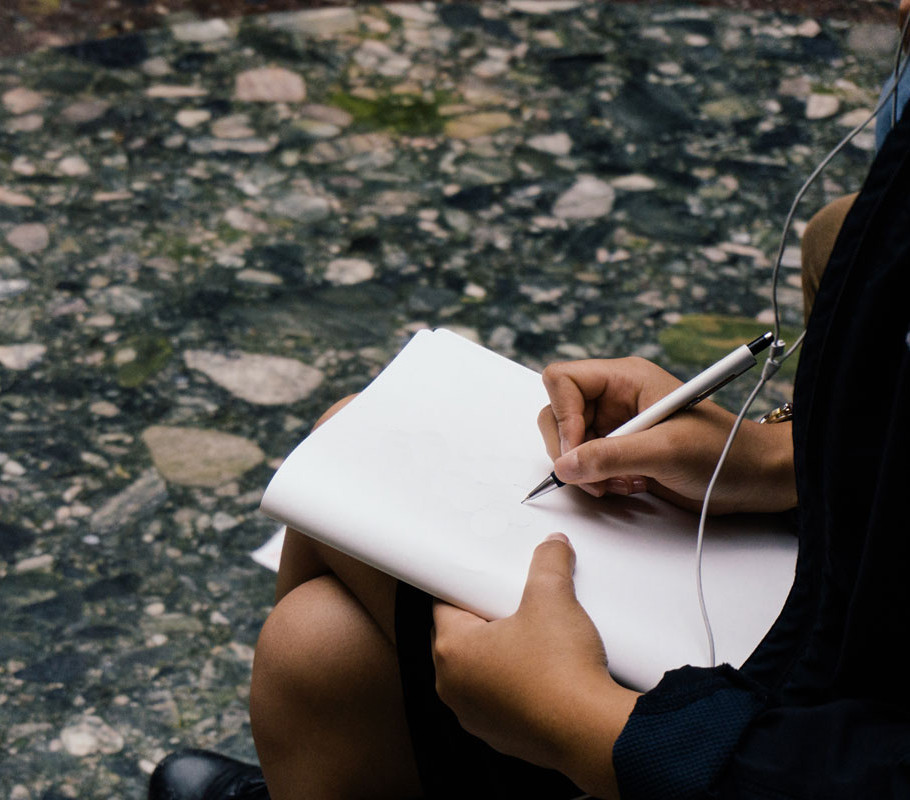 Image of woman journaling to create a ritual